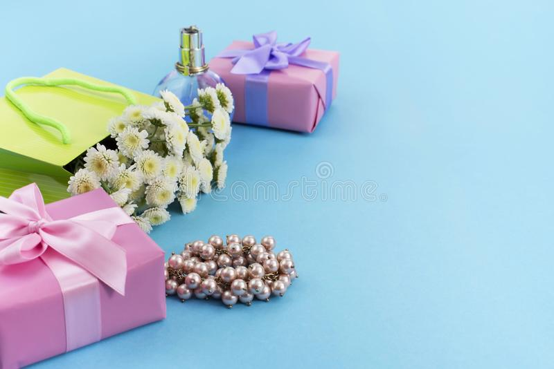 Decorative composition boxes with gifts flowers women's jewelry shopping holiday blue background. stock photography