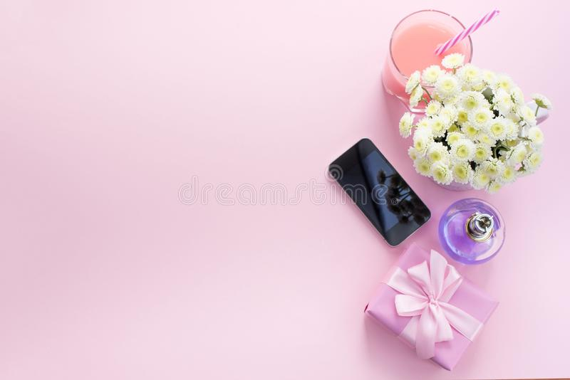 Decorative composition flat lay set of items flowers mobile perfume cocktail gift Top view copy space stock image