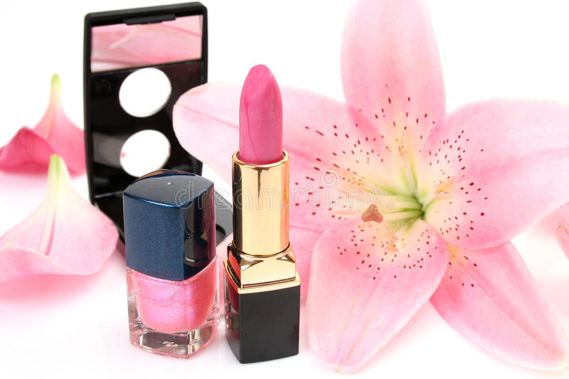 Decorative cosmetics. And pink flower royalty free stock photo
