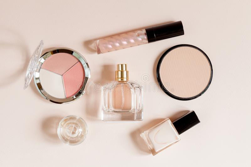 Decorative cosmetics on beige background. Top view. Decorative cosmetics concept. Woman theme royalty free stock image