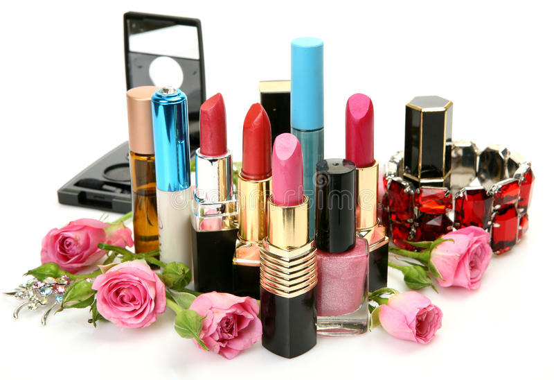 Decorative cosmetics and roses. Decorative cosmetics on a white background stock images
