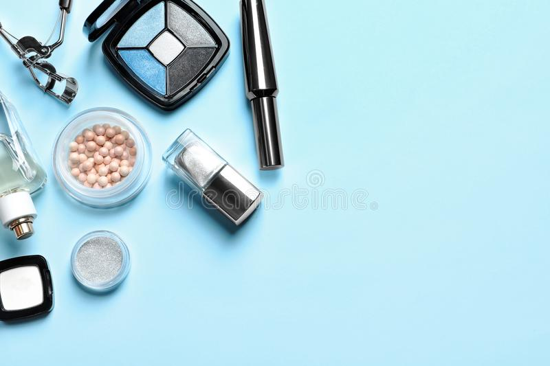 Decorative cosmetics and tools. Of professional makeup artist on color background royalty free stock photos
