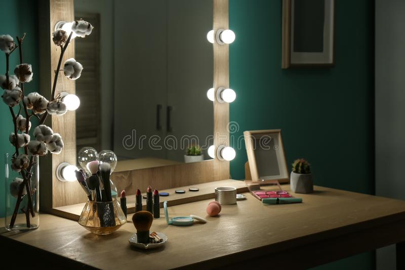 Decorative cosmetics and tools on dressing table. Near mirror in makeup room stock photography