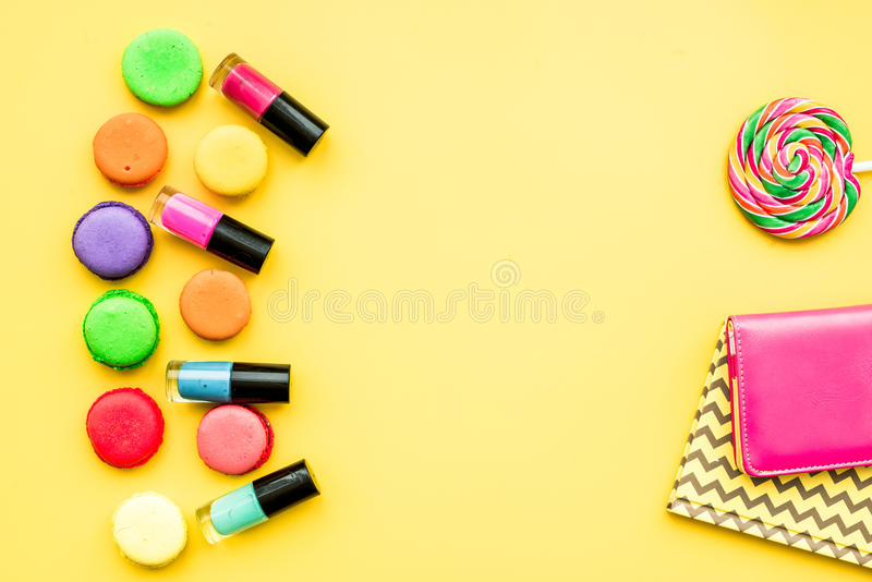 Decorative cosmetics on yellow background top view.  stock image