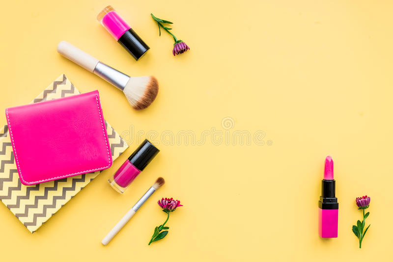 Decorative cosmetics on yellow background top view royalty free stock photo