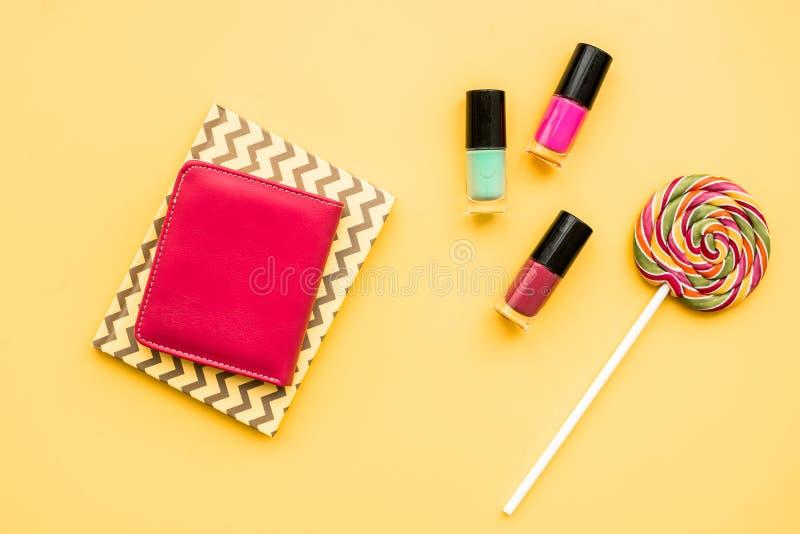 Decorative cosmetics on yellow background top view.  stock photo