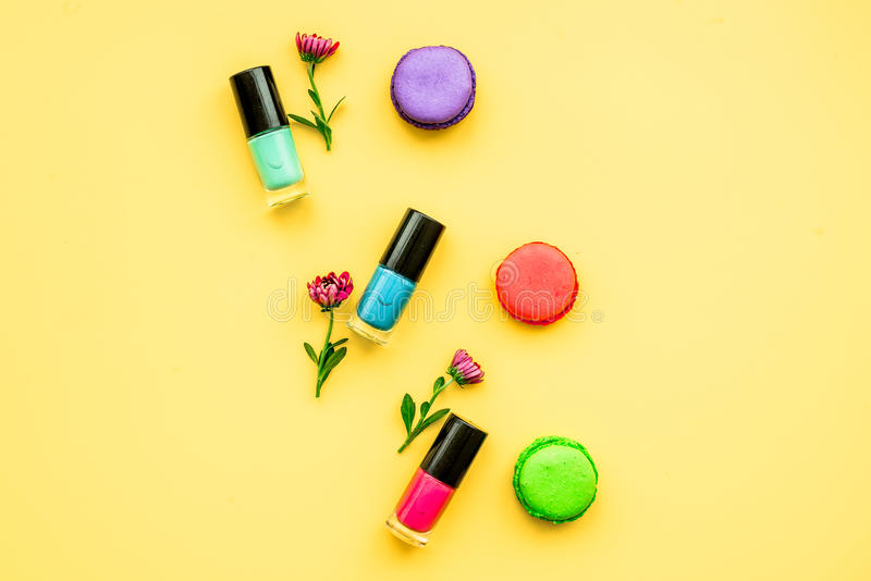 Decorative cosmetics on yellow background top view.  royalty free stock photo