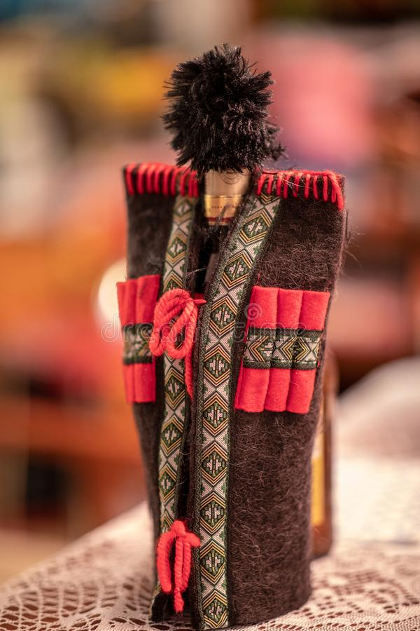 Decorative cover for a wine bottle. Representing Georgian Traditional Male costume stock photos