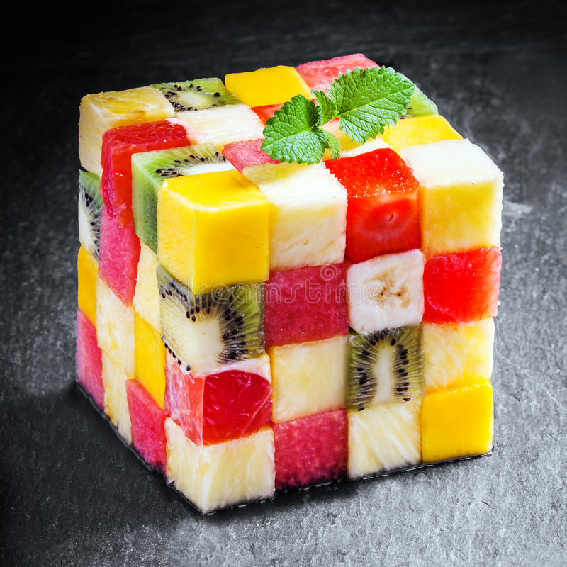 Decorative cube of diced fresh summer fruit stock photography
