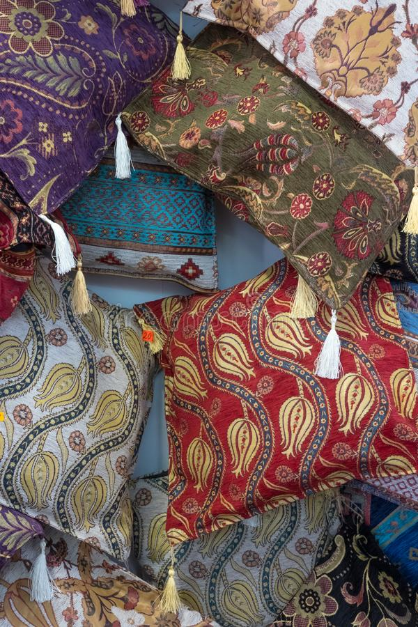 Decorative cushions for sale in Bulgarian souvenir store. Assortment of small, ornate cushions decorated with motifs of flowers and leaves were for sale in stock photo
