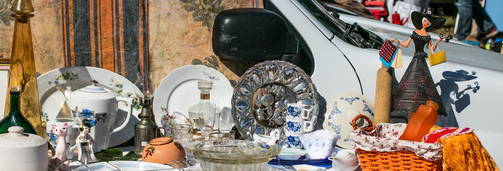 Decorative display of household objects and dishes at boot sale. Decorative display of household things, various objects and dishes at boot sale for second hand stock image