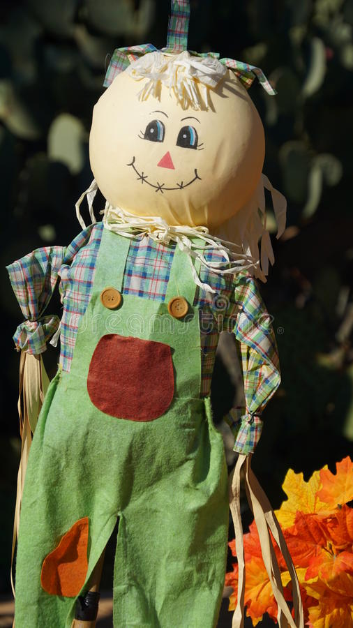Decorative doll farm workers outfit. Decorative doll (character) made for the Fall and Halloween celebrations wearing green drill trousers, check shirt and big royalty free stock photos