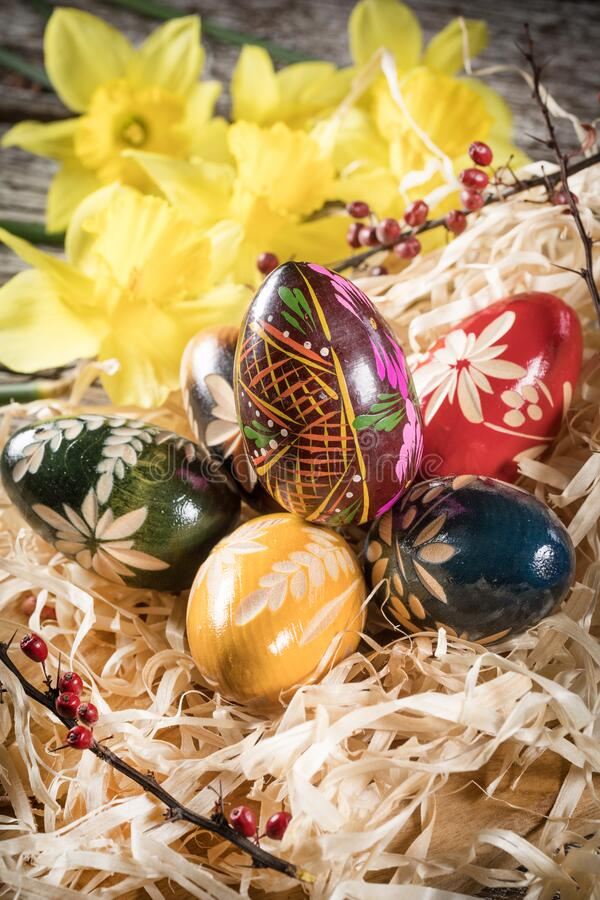 Decorative Easter eggs. Decorated eggs on a wooden board. Shallow depth of field royalty free stock photo
