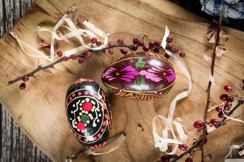 Decorative Easter eggs. Decorated eggs on a wooden board. Shallow depth of field stock photography