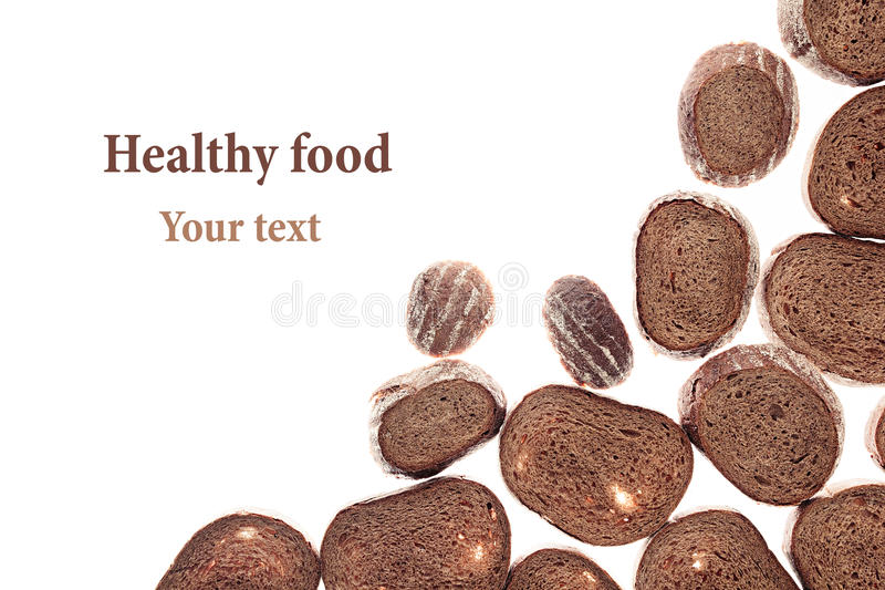Decorative edging pieces of black rye bread on a white background. Isolated. Border. Pattern. Food background. View from above royalty free stock photography