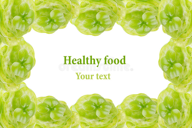 Decorative edging of the piles of green pepper on a white background. Isolated. Frame. Food background. Copy space stock photography