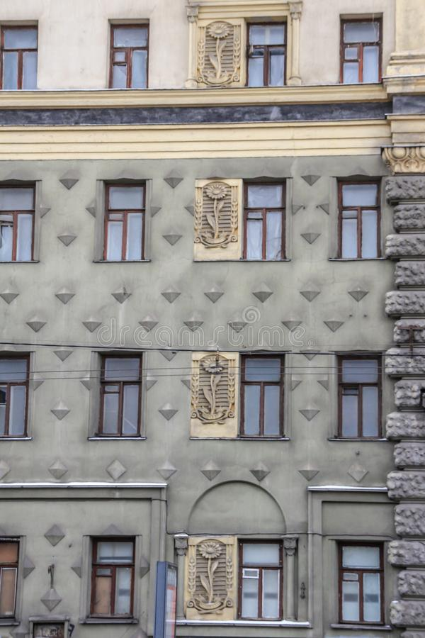 Decorative elements on the wall of building. Architecture of USSR. Festive and decorative elements, blur and grain effect. royalty free stock photo