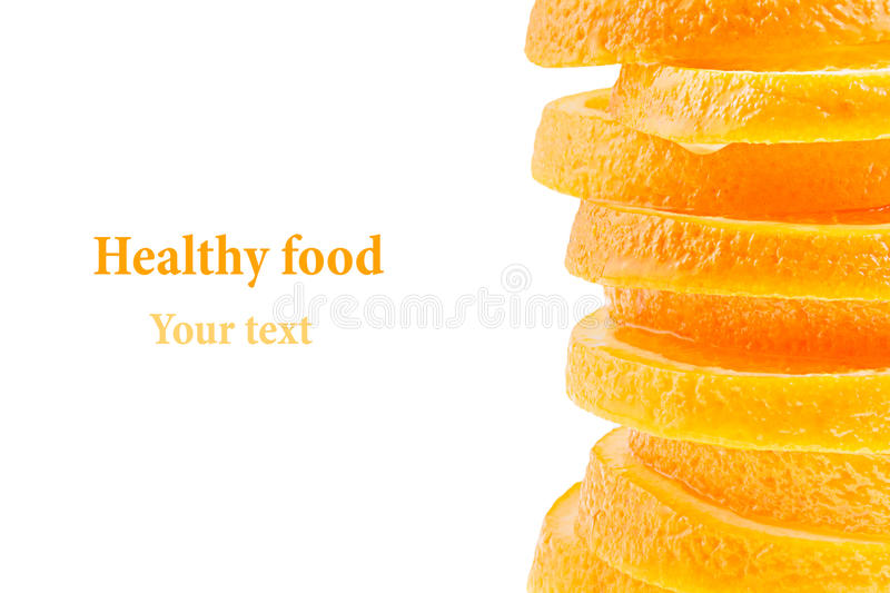 Decorative ending from a pile of slices of juicy orange on a white background. Fruit border, frame. Isolated. Food background. Cop. Y space. Concept art royalty free stock photo