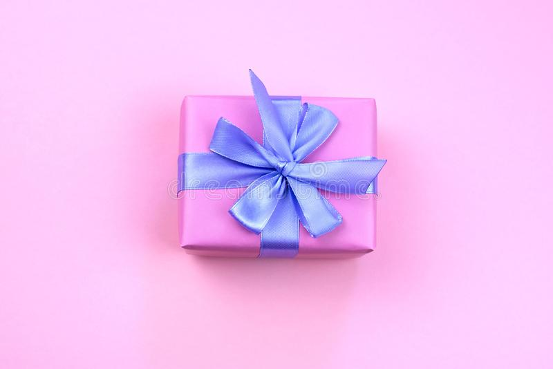 Decorative festive gift box with pink color on pink background. royalty free stock photos