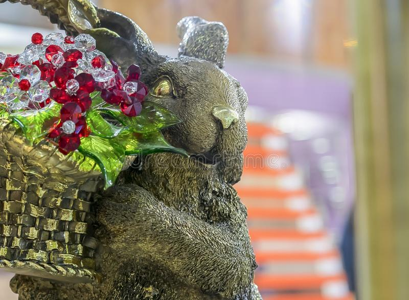 Decorative figurine of a rabbit with a basket of flowers.  stock images