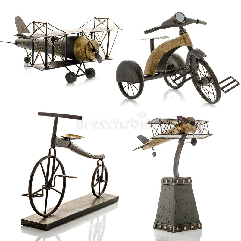 Decorative figurines, statuette of a bicycle and an airplane, accessories royalty free stock image