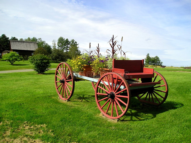 Decorative Flower Wagon. Display of flowers on an old horse-drawn wagon royalty free stock image