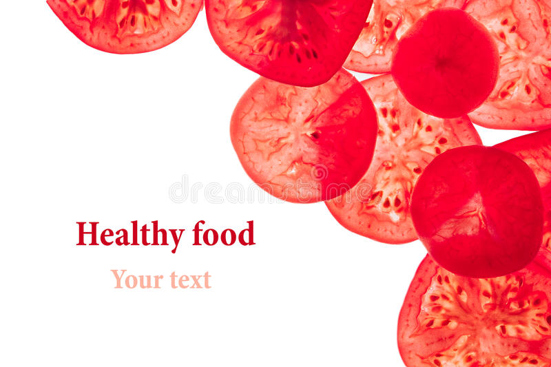 Decorative frame of slices of tomatoes on a white background. Isolated. Tomatoes sliced circles. Frame, border from vegetables. stock photo