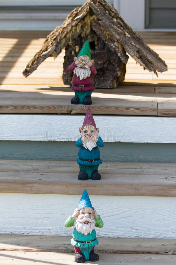 Decorative garden gnomes in front of house entrance. Garden gnomes in front of house entrance stock photos