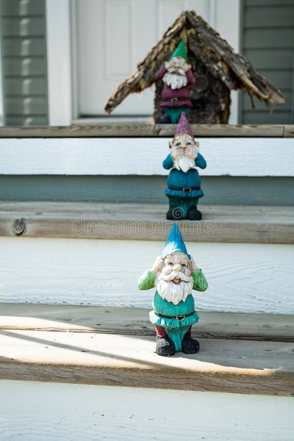 Decorative garden gnomes in front of house entrance. Garden gnomes in front of house entrance stock photography