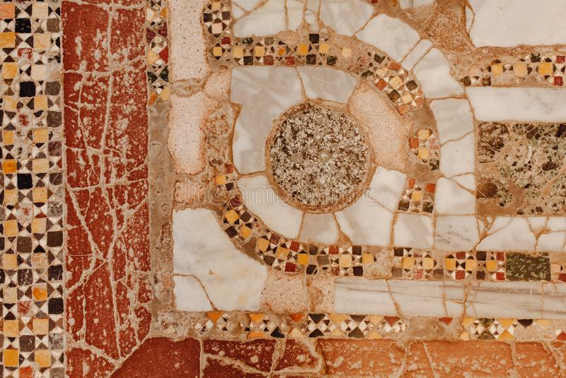 Decorative Geometric Mosaic Stone Wall Background stock photos