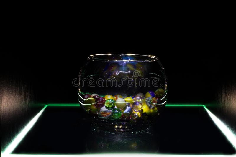Decorative glass balls in a vase royalty free stock photo