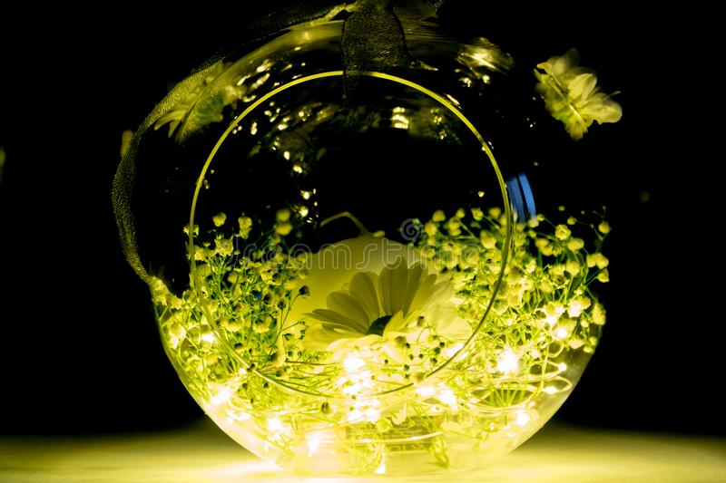 Decorative Glass Candle Bowl with Flowers and Lights stock photos