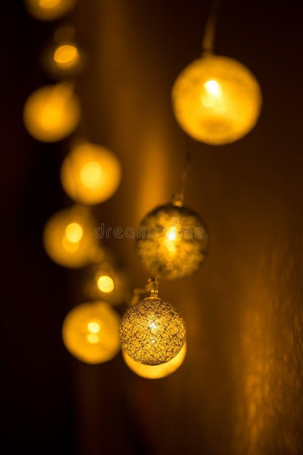 Decorative globe, light bulbs. On the wall. Hanging lights. Selective focus royalty free stock photos