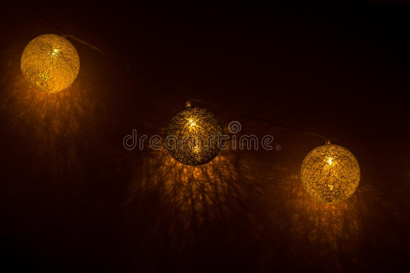 Decorative globe, light bulbs. On the wall. Hanging lights. Selective focus stock images