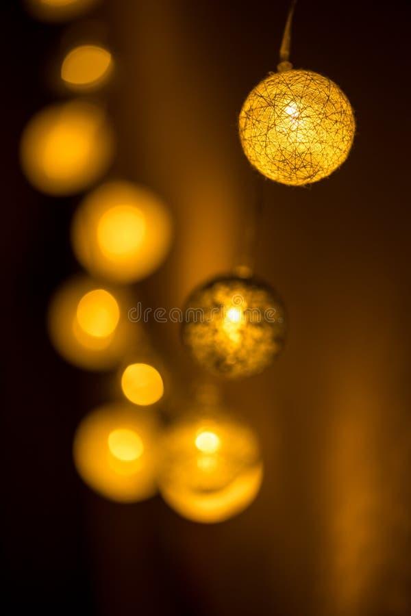 Decorative globe, light bulbs. On the wall. Hanging lights. Selective focus stock photography