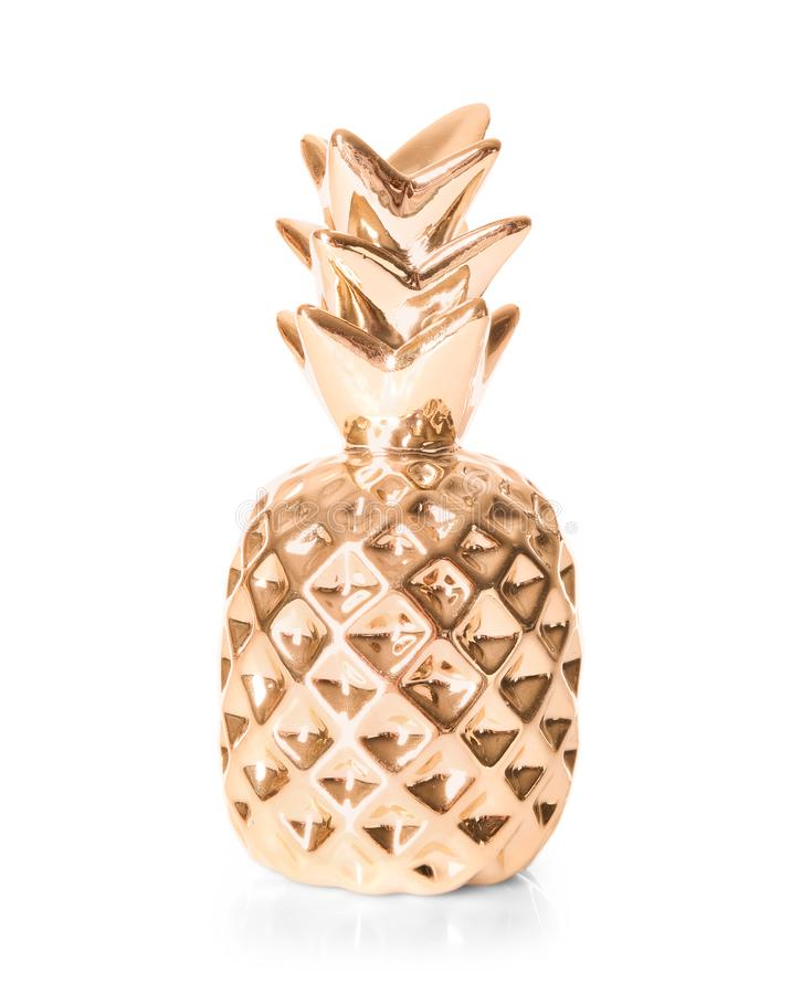 Decorative golden pineapple on white background royalty free stock photo