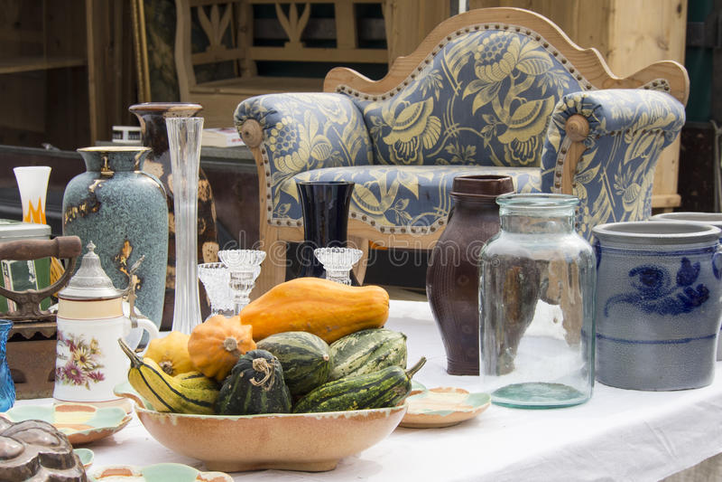 Decorative gourds seen on flea market. Italian flea market presents a bowl with decorative gourds stock image