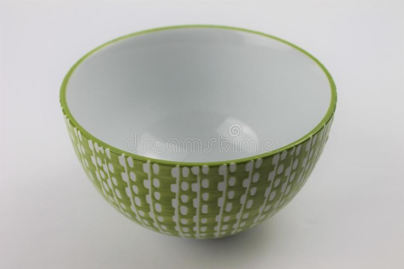 Decorative Green and White Glass Bowl on a White Background Isolated stock photography