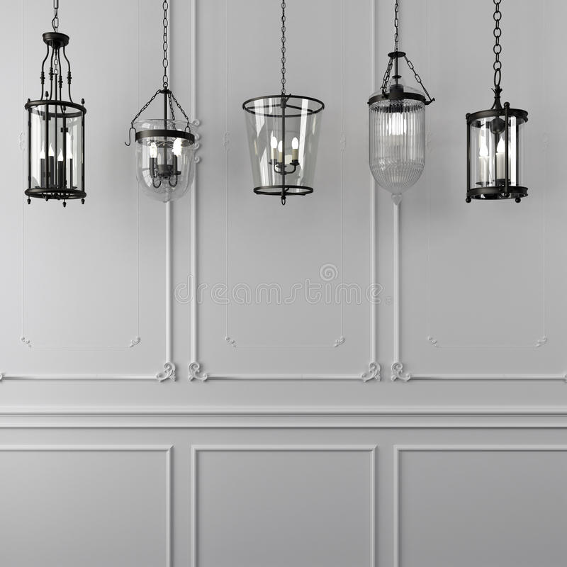 Decorative hanging lamps against a white wall. Glass hanging lamps with wrought basis against a white wall with decor royalty free stock photos