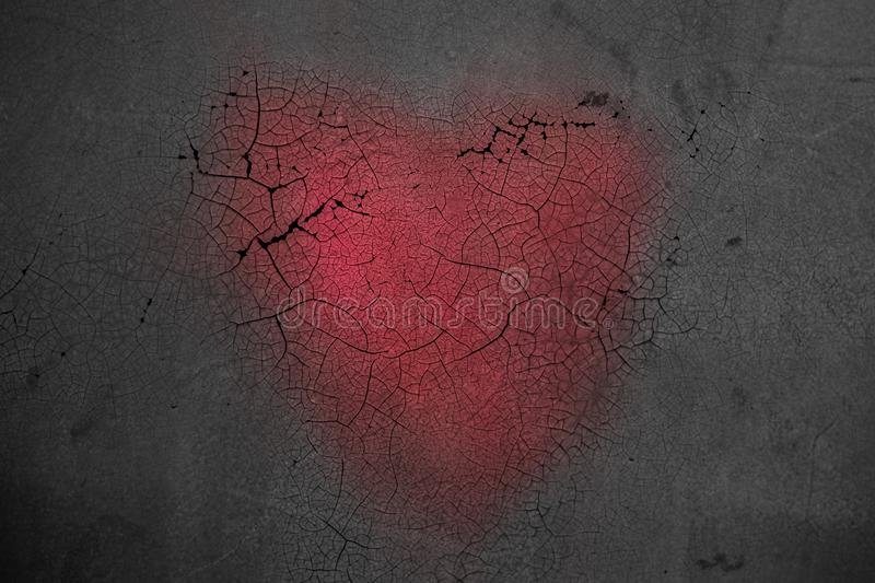 Decorative heart on dark wooden background with bright white light from the window. The concept of fading love. The end royalty free stock photography