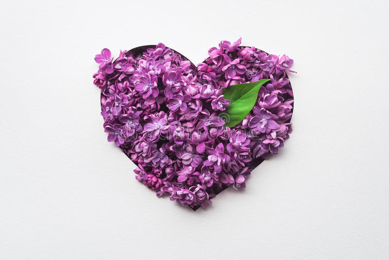 Decorative heart made of lilac flowers stock photo