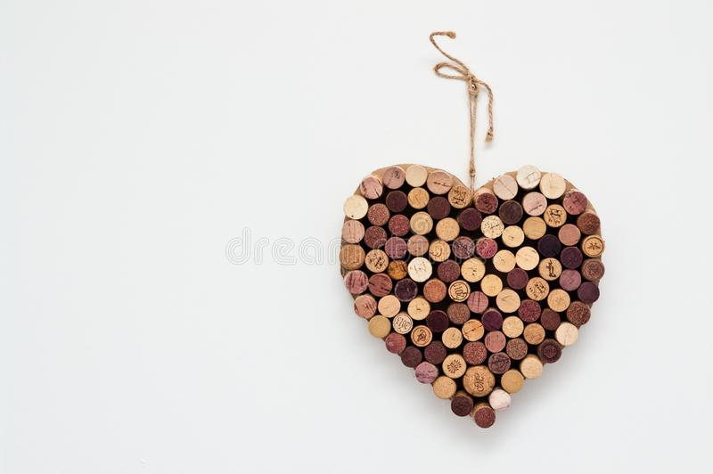 Heart made of wine corks isolated on white wall royalty free stock photo