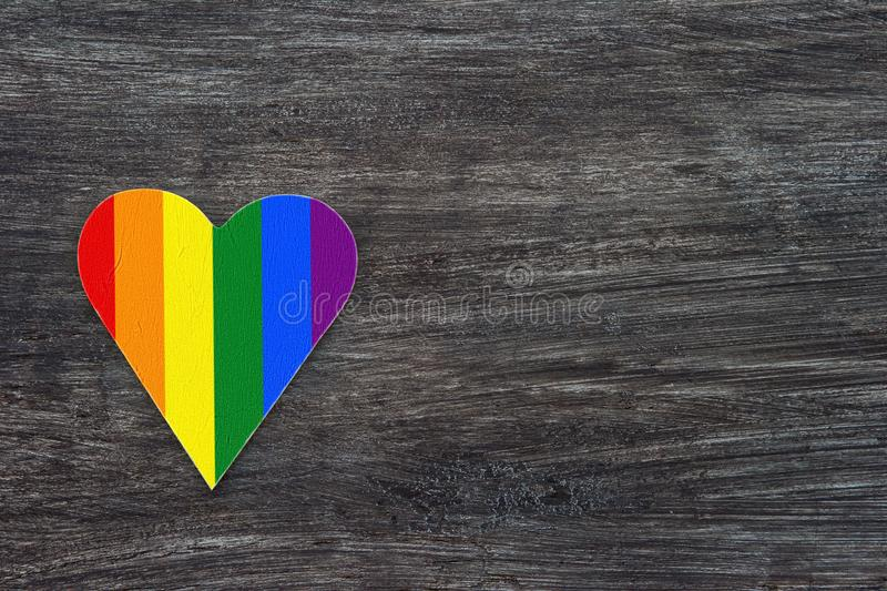 Decorative Heart with rainbow stripes on gray wooden background. LGBT pride flag, symbol of lesbian, gay, bisexual, transgender.  royalty free stock image