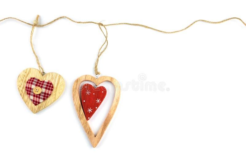 Decorative hearts on wood. stock photo