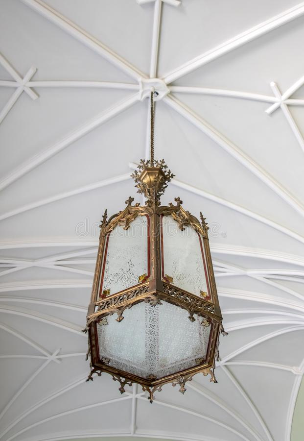 Decorative historic light hanging on a Gothic net vault royalty free stock photos
