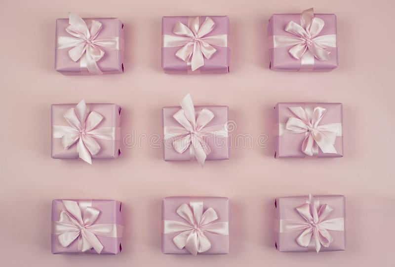 Decorative holiday gift boxes with pink color on pink background. Flat flat top view royalty free stock image