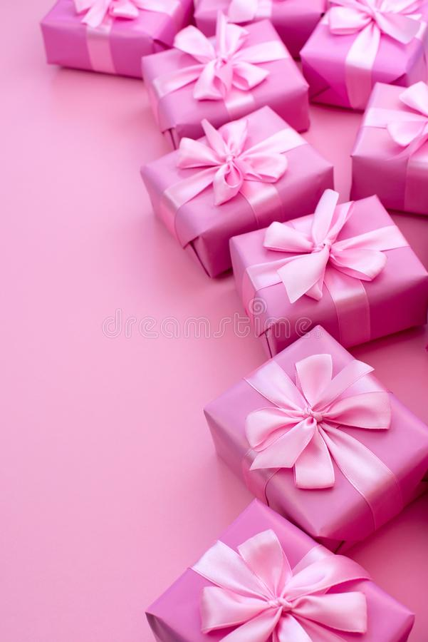 Decorative holiday gift boxes with pink color on pink background. Flat flat top view royalty free stock photography