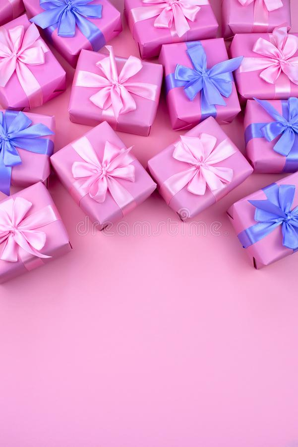Decorative holiday gift boxes with pink color on pink background. Flat flat top view stock images