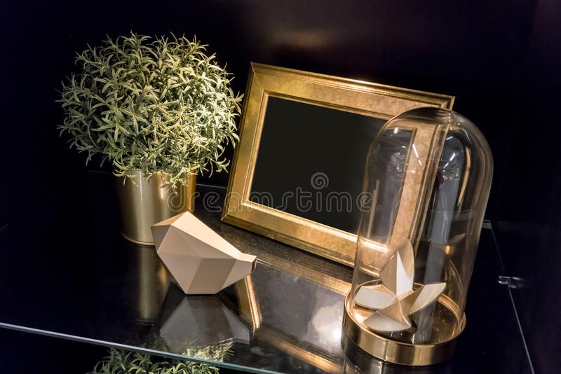 Decorative interior details on glass shelf of black cabinet. Int stock images