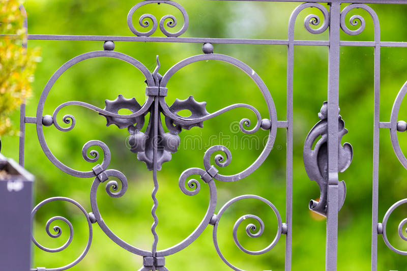 Decorative ironwork design. Closeup of decorative metal design or ironwork on a fence or gate royalty free stock images